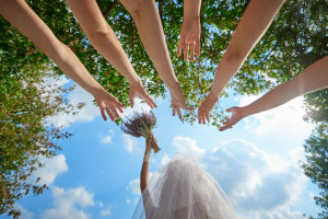 bride throws the bouquet to unmarried girls Wedding Traditions.
