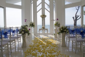 White alter with rose petals in walkway
