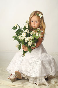 Young Blonde girl holding flowers