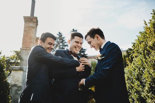 Photo of groomsmen having fun