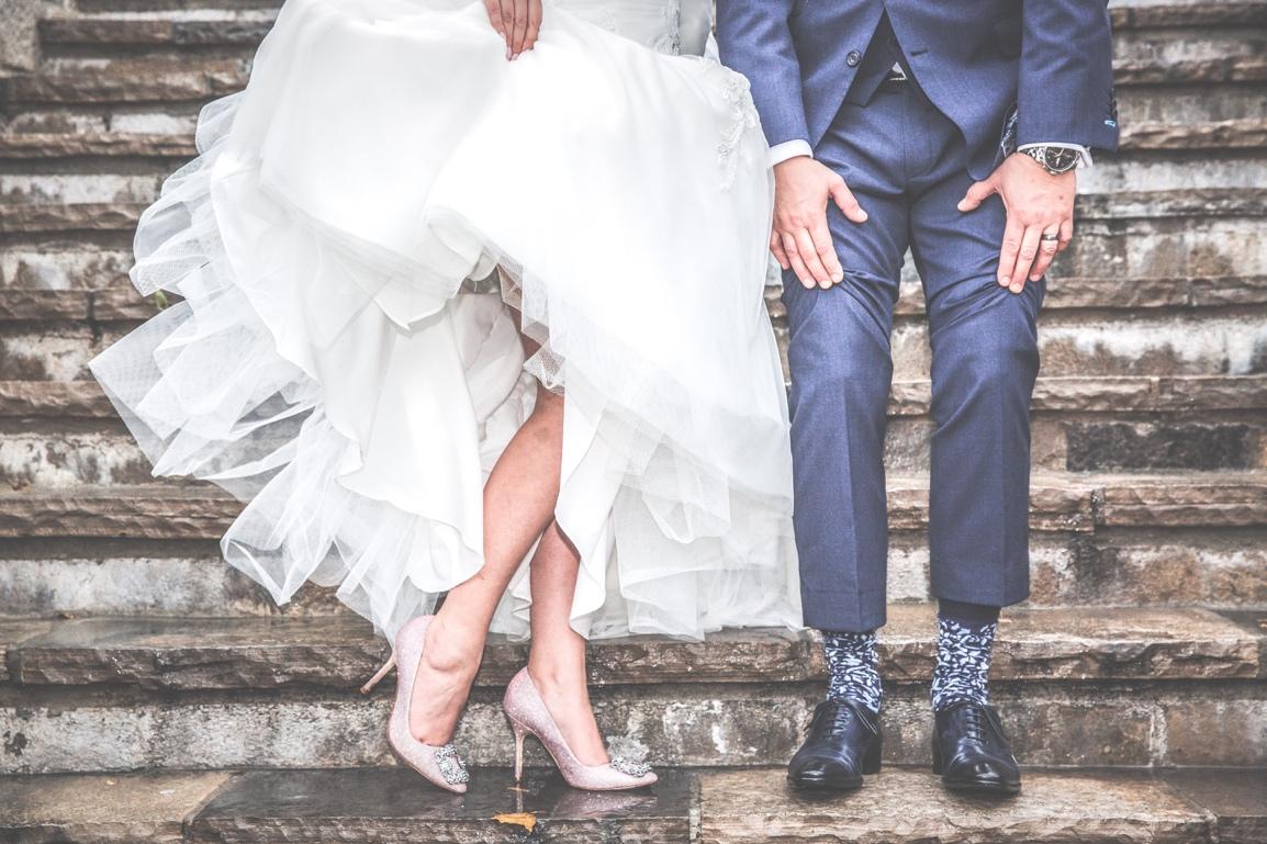 Bride and groom waist down