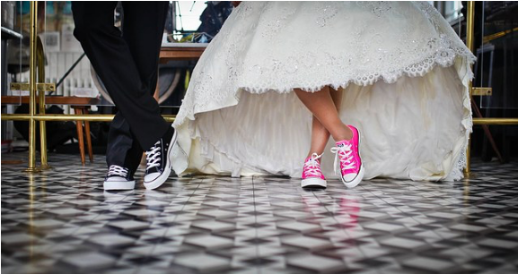Wearing wedding dress with converse shoes