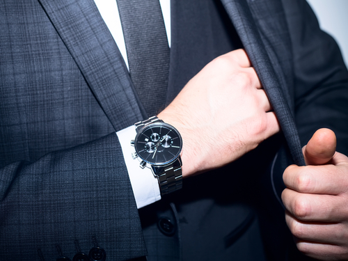 closeup of luxury watch on mans wrist