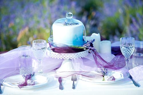 lavender wedding cake on serving table