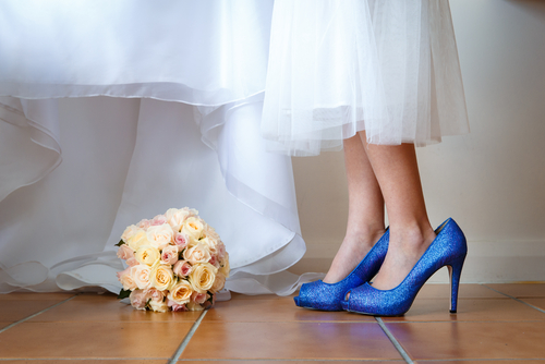The flower girl in a high heels on a wedding day