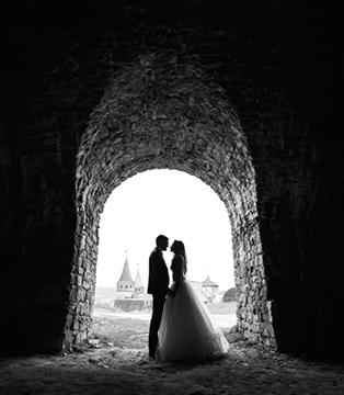 married couple standing in doorway