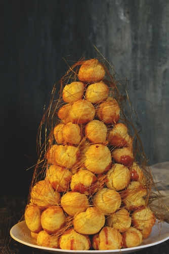 croquembouche in cone shape on plate