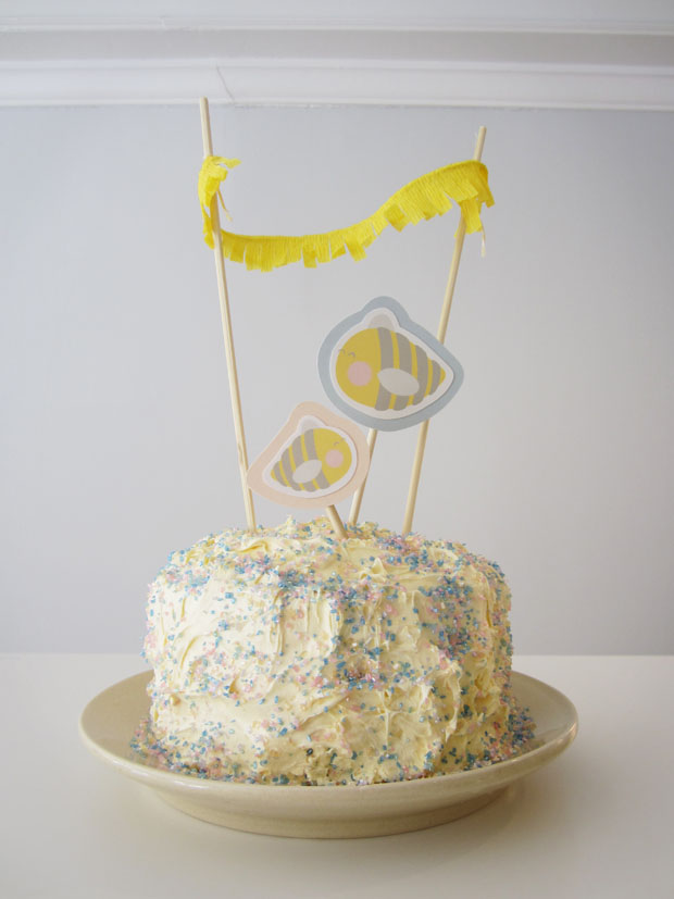 baby reveal cake with baby bees and fringe bunting cake toppers