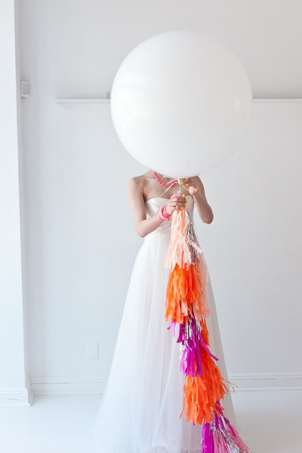 bride with geronimo balloon and neon tassels