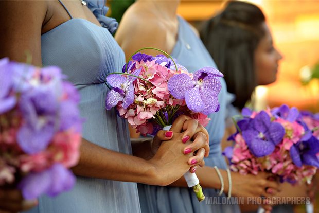 The bridesmaids' dresses and orchid bouquets