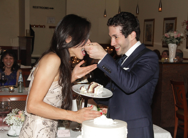 Christina and Andy enjoy wedding cake at their Jewish reception