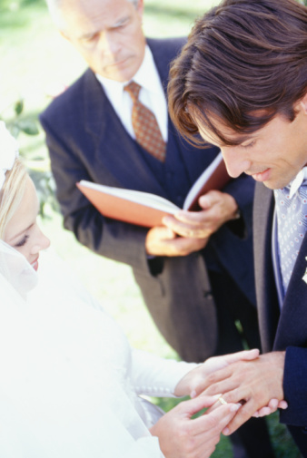 A couple exchanging rings