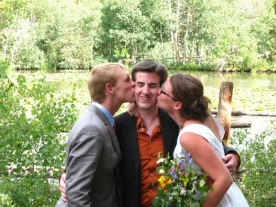 Happy couple kissing their officiant