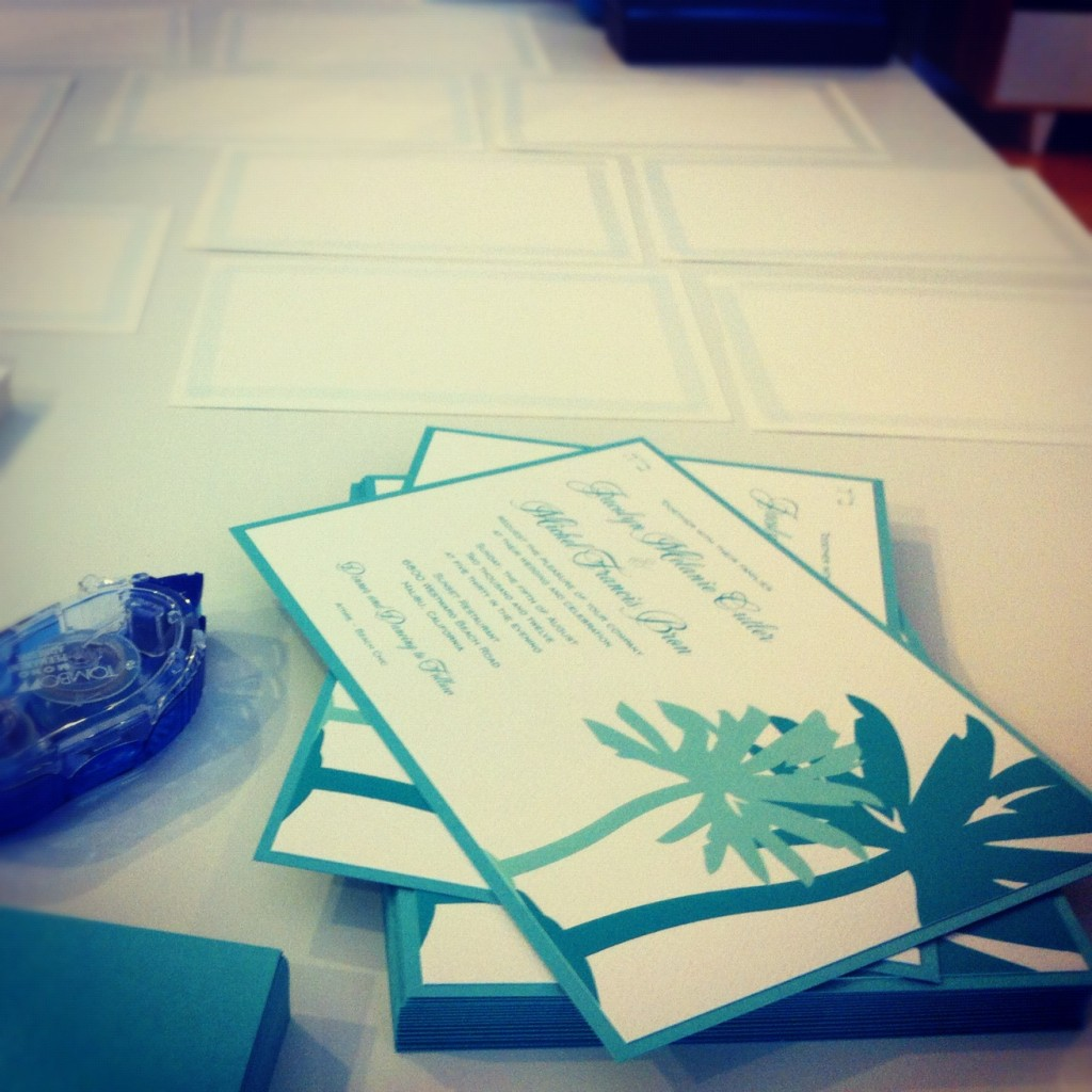 the green kangaroo's layered palm wedding invitation