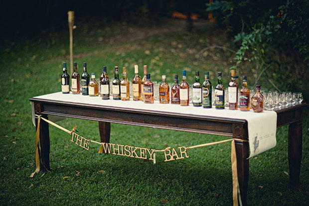 groom wedding trends: whiskey bars for the guys