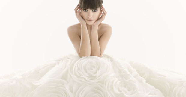 Girl in white wedding dress with roses