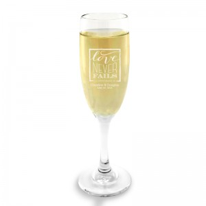 Love Never Fails Champagne Glass